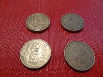 four 100 Peso Mexican coins in The Woodlands, Texas