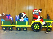 santa riding tractor in Fort Polk, Louisiana